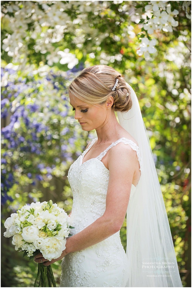 Bride with floral backdrop - photography by Samantha brown
