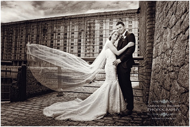 Bride and Groom walking outside The tobacco warehouse Liverpool