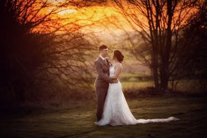 Bride and Groom at sunset in the grounds of West Tower