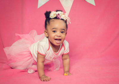 little girl with a pink background