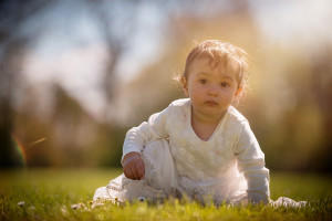 baby girl on the grass by Samantha brown photography
