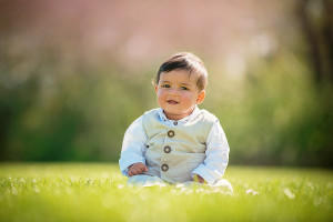little boy sitting in the park