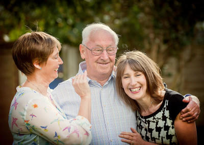 father with his two daughters laughing by Samantha Brown Photography