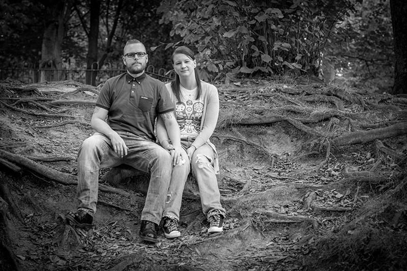 couple sitting with tree roots in Formby