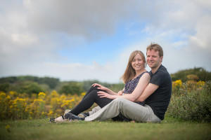 couple sitting on the grass in Formby woods