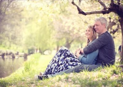 couple in the blossom trees by Samantha Brown Photography