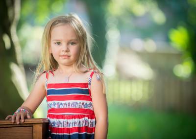 little girl in a stripped dress