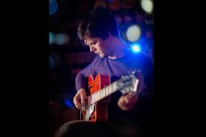 portrait of Andy Frampton at Harmonics guitar shop Crosby by Samantha Brown Photography