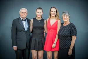 two sisters with their grandparents