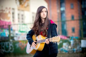teen girl playing guitar by Samantha Brown photography