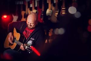 portrait of Tim Cunningham at Harmonics guitar shop Crosby