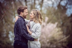 Couple embracing at Tilstone House Gardens in Spring by Samantha Brown Photography