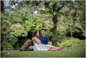 couple sitting under a cherry tree