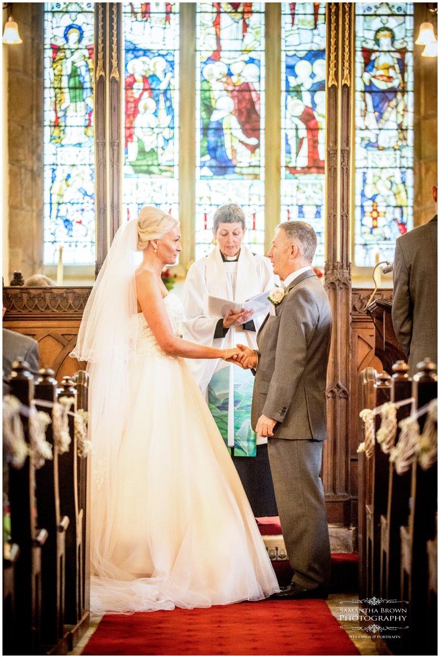 a couple getting married at Lathom Chapel