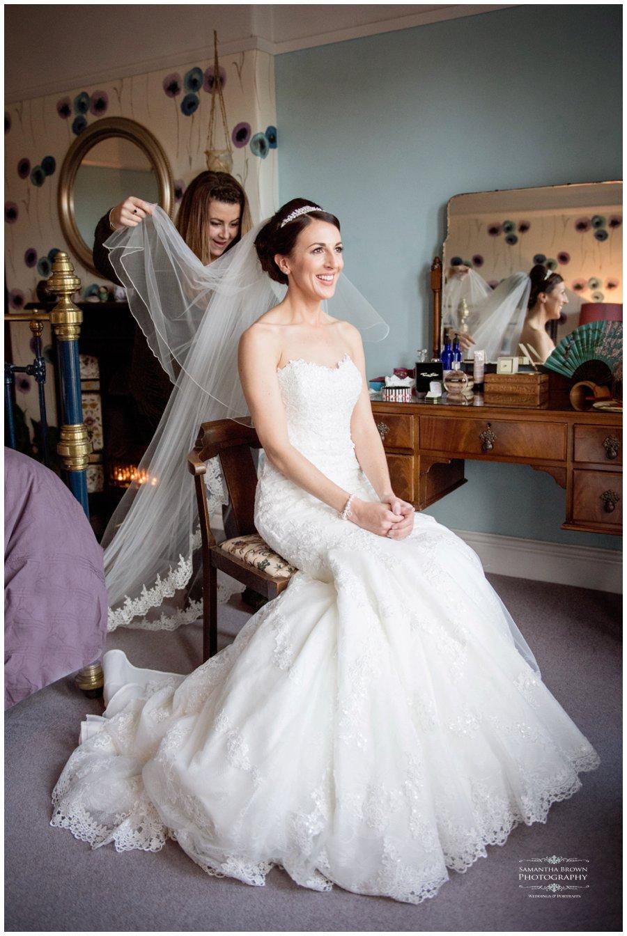 view being put onto bride