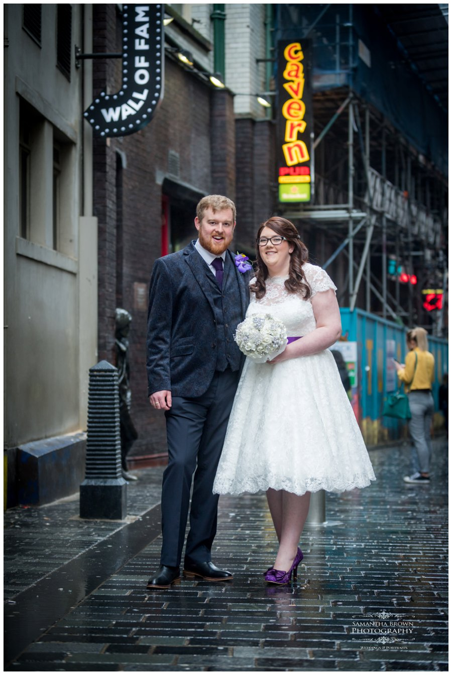 Bride and groom walking down Matthew street