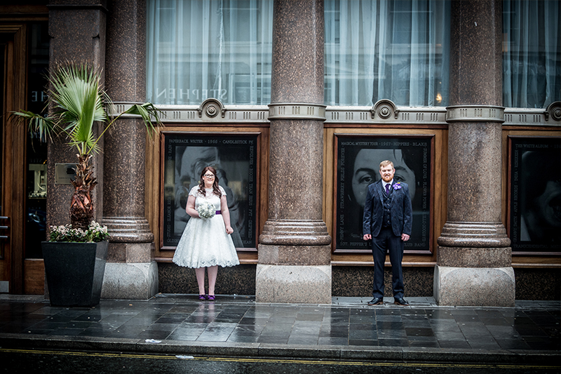 bride and groom standing outside Hard days Night Hotel Liverpool