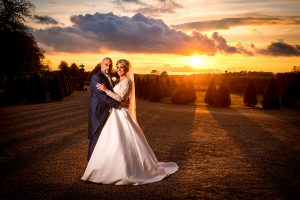 bride and groom at Knowsley Hall in the sunset