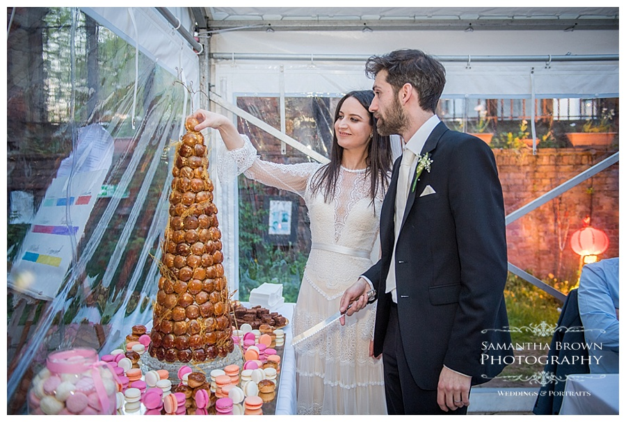 St Lukes Bombed out Church Liverpool wedding Bride and Groom cutting the cake