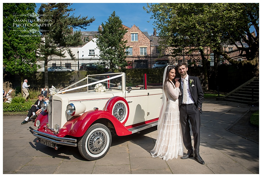 St Lukes Bombed out Church Liverpool Gardens wedding reception Bride and groom in wedding car