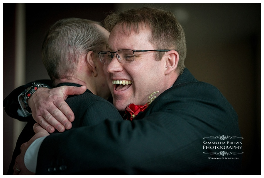 Mike the groom and best man hugging at Malmaison Liverpool